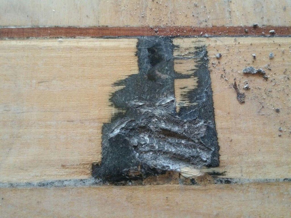 Parquet hidráulico castaño mancha de brea